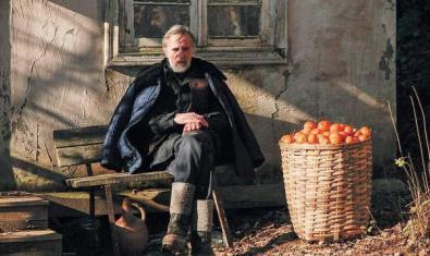Cartell de la pel·lícula on es veu un home i cabàs de mandarines