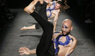 The artists performing contemporary dance on stage.