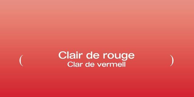 El cartell de l'exposició mostra un fons vermell amb el títol de l'exposició sobreimprés