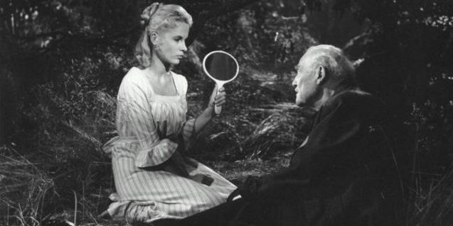 The old man and his daughter-in-law sitting in the forest, she's showing him a mirror.