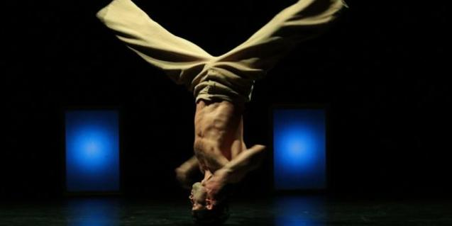 A man performing a pirouette.