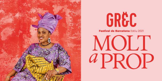 Una imagen del cartel que anuncia el festival y que muestra a una mujer con un traje de colores vivos y con un pañuelo en el ninguno sentada sonriendo con un fondo de color rojo tras de sí