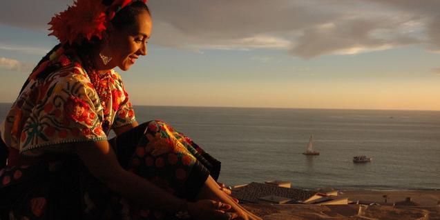 Retrat de l'artista amb un paisatge marítim al fons