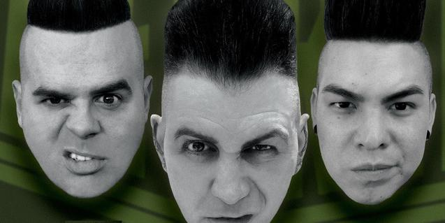 Els tres membres de la banda amb els seus tupés característics