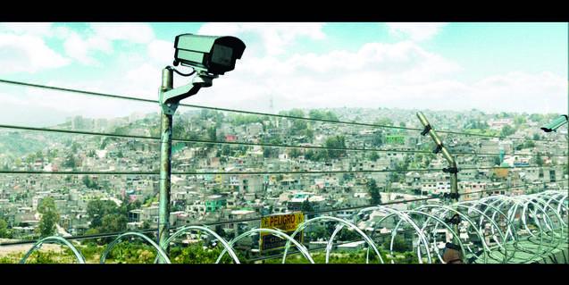 A still photo from 'La Zona'