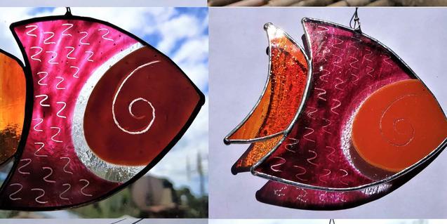 Uns peixos pintats sobre vidre, de Vitraloi.
