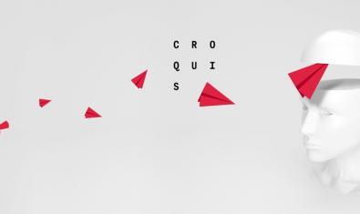 El cartel que anuncia la actividad muestra a un personaje lanzando aviones de papel contra una gran cabeza de color blanco
