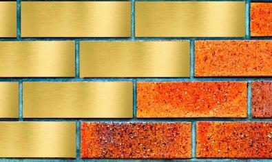 Una pared de ladrillos que han sido pintados de color dorado para simular oro