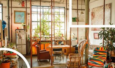 Una imagen de un cuarto de estar de esta fábrica de creación con unos grandes ventanales por los cuales entra la claridad
