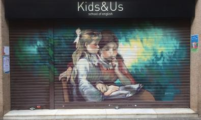 'The Reading' by Renoir reproduced on the shutters of a shop in Carrer de Can Bruixa