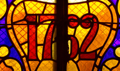 A stained glass window in the Royal School of Medicine