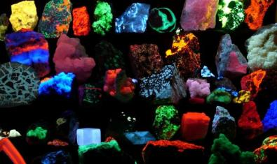 Fluorescent coloured objects on a black background.