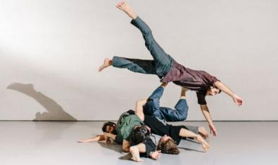 The dancers on the floor, one on top of the other.