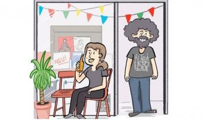 Els responsables de la botiga de discos del Poblenou dibuixats a la porta de l'establiment