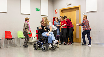 A group of people with disabilities taking part in a dancing activity