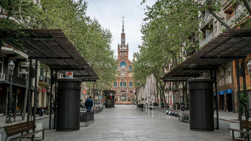 Avinguda de Gaudí with the Hospital de Sant Pau in the background. Only one person can be seen, walking out of an underground car park