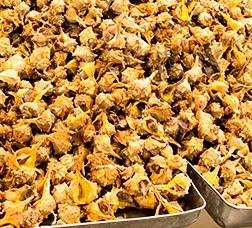 Sea snails seasoned with olive paste