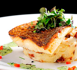 Oven-baked sea bream with its own garnish