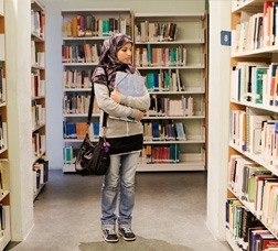 Young Pakistani in a library