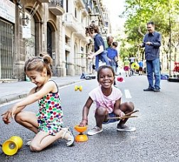 Children playing in a activity on the street