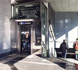 Man in a wheelchair using the elevator at a metro station