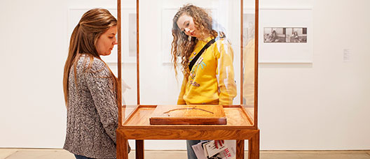 Two girls looking at an exhibition