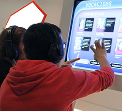 Two people touching a touchscreen to access content
