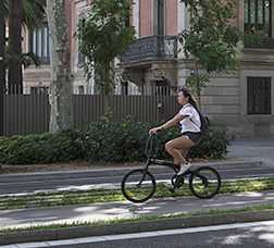 A cyclist riding along a bike lane