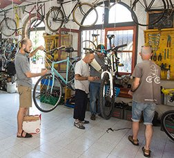 People repairing bicycles in a workshop.