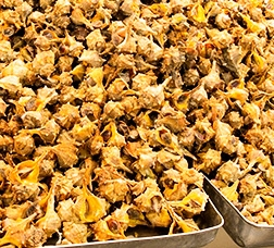 Sea snails seasoned with olive paste