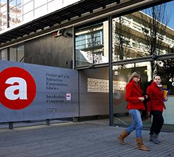 Two young women opposite one of Barcelona Activa's headquarters