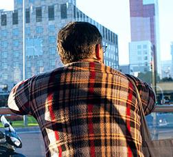 A man looking through a bus window