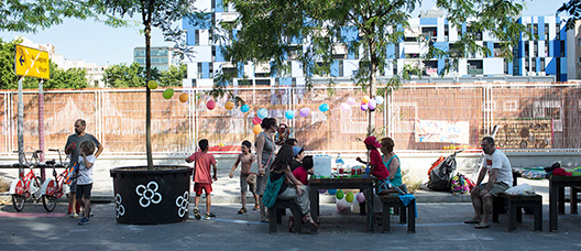 Families celebrating a party at the street