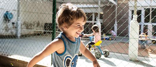 A boy plays in a nursery school playground