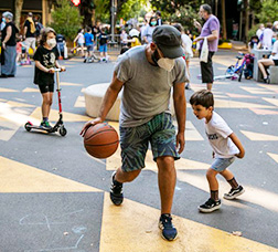 A man and a kid playing basketball