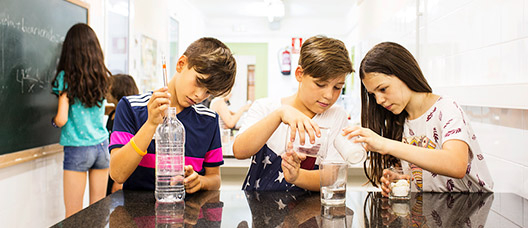 A group of children do an experiment in a lab at school