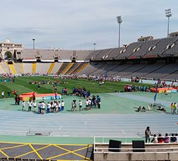 People on the Montjuïc Olympic stadium's tracks