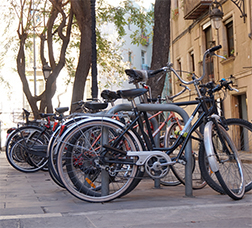 Row of bicycles parked in a street parking point