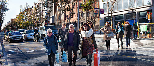 Pedestrian crossing with people crossing