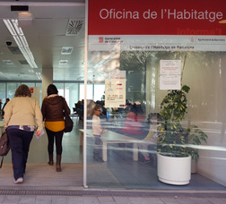 Two people entering a housing office
