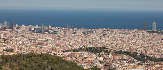 Panoramic view of Barcelona with the sea on the foreground