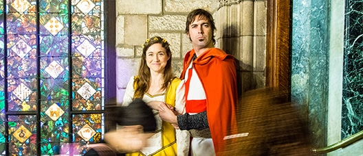 An actress and an actor playing the princess and Sant Jordi [St George] inside the City Council