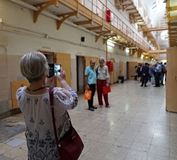 Visitors taking photos inside the old Model prison