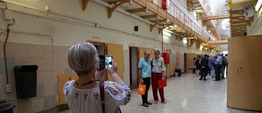 Visitors taking photos inside the old Model prison