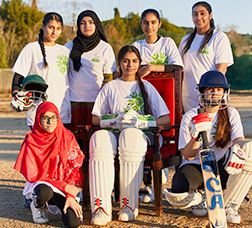 Players of a women's cricket team posing for a photo