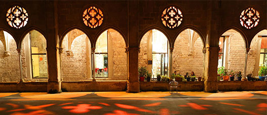 Patio of the Sant Agustí convent at night with red lights